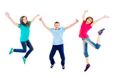 Happy kids jumping. Isolated on white background Stock Images