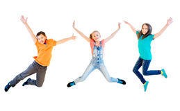 Happy kids jumping. Isolated on white background Royalty Free Stock Photos