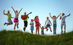 Free Happy Kids Jumping On Summer Field Stock Photos - 34229373