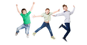 Happy kids jumping at studio, copy space Royalty Free Stock Images