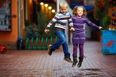 Happy kids jumping under the rain Stock Images