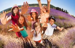 Happy kids in lavender field reaching out hands Royalty Free Stock Photo