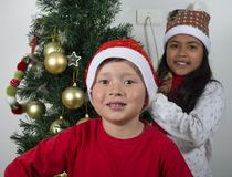 Happy kids laying under the christmas tree. Royalty Free Stock Image