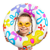 Happy kids look out of inflatable ring Royalty Free Stock Photo