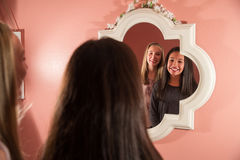 Happy kids looking in the mirror Royalty Free Stock Image