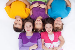 Happy kids lying on the floor Royalty Free Stock Images