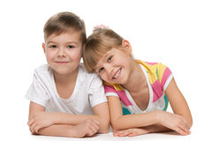 Happy kids. Are lying together on the floor stock photo