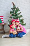 Happy kids near Xmas tree Royalty Free Stock Photos