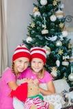 Happy kids near Xmas tree Royalty Free Stock Image