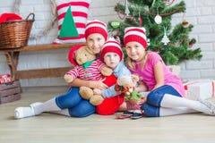 Happy kids near Xmas tree Stock Image