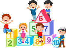 Happy kids with numbers blocks Stock Image