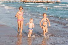 Free Happy Kids On The Beach Stock Photography - 74501602