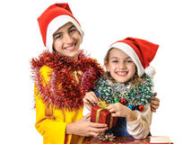 Happy kids opening Christmas gifts Stock Photos