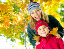 Happy kids outdoors. Happy Kids having fun in Autumn Park royalty free stock photos