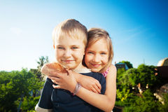 Happy kids outdoors Stock Image