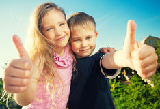 Happy kids outdoors Stock Photos