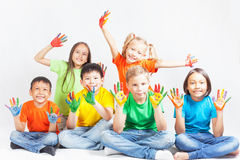Happy kids with painted hands smiling Stock Photos