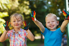 Happy kids with painted hands Royalty Free Stock Photo