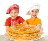 Happy kids with pancakes Royalty Free Stock Photo