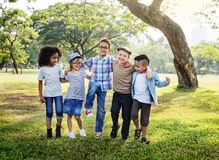 Happy kids in the park stock photography