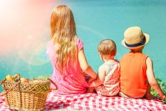 Happy kids on a picnic by the sea in nature royalty free stock photo