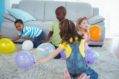 Happy kids playing with balloons Stock Image