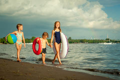 Happy kids playing on beach Stock Photography
