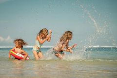 Happy kids playing on the beach Royalty Free Stock Photo