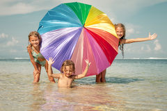 Happy kids playing on the beach Royalty Free Stock Images