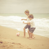 Happy kids playing on beach Stock Image