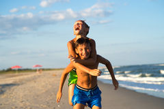 Happy kids playing on the beach on holidays. Stock Photography