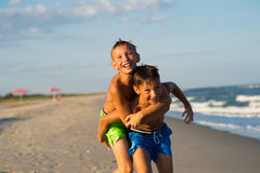Happy kids playing on the beach. Stock Images