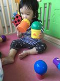 Baby girl play with balls royalty free stock photo