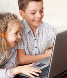 Happy kids playing computer Stock Photo