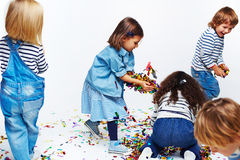 Happy Kids Playing with Confetti Royalty Free Stock Photos
