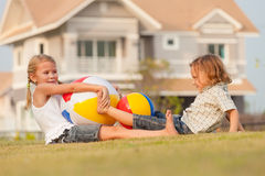 Happy kids playing on the grass. Stock Photo