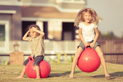 Happy kids playing on the grass. Stock Photography