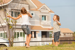 Happy kids playing on the grass. Stock Images