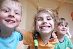 Happy kids playing at home. Three happy kids playing together Royalty Free Stock Images