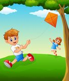 Happy kids playing kite Royalty Free Stock Images