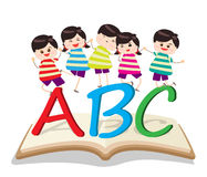 Happy Kids Playing with letter and on book Royalty Free Stock Photos