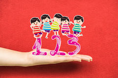Happy Kids Playing with number and on a hand Royalty Free Stock Photography