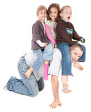 Happy kids playing riding on back of dad. Kids riding on dad's back. Isolated on white Royalty Free Stock Photography