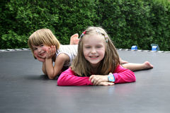 Happy kids playing together outdoor. Royalty Free Stock Image