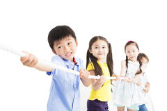 Happy Kids playing tug of war Royalty Free Stock Photography