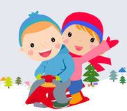 Happy kids playing in winter Royalty Free Stock Photo