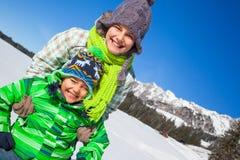 Happy kids playing winter Stock Photo