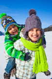 Happy kids playing winter Royalty Free Stock Photography