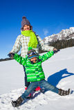 Happy kids playing winter Stock Image