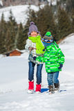 Happy kids playing winter Stock Photo